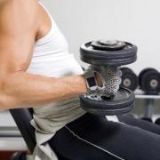 man lifting weights at a gym